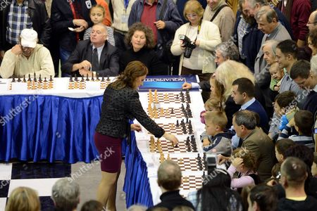 Hungarian Chess Grandmaster Judit Polgar (c) Plays a 100 Board Simultaneous Chess Game During the Vi Aquaprofit-polgar International Chess Fest in Budapest Hungary 17 November 2012 Hungary Budapest