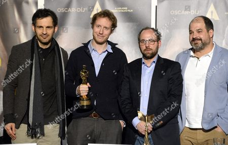 Hungarian Director Laszlo Nemes Jeles (2-l) Holds an Oscar Statuette That was Won in the Best Foreign Language Film Category of the 88th Academy Awards For 'Son of Saul' in the Company of Lead Actor Geza Rohrig (l) and Producers Gabor Sipos(2-r) and Gabor Rajna (r) During Their Press Conference Held in Budapest Hungary 02 March 2016 Hungary Budapest