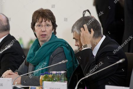 European Union High Representative For Foreign and Security Policy and Vice President of the European Commission Catherine Ashton (l) Sits Next to Deputy Secretary General For Inter-institutional Affairs of European External Action Service Maciej Popowski (r) of Poland at the Beginning of an Informal Meeting of Defence Ministers of Eu in Grassalkovich Palace in Goedoelloe Some 30 Km Northeast of Budapest Hungary 09 February 2011 Hungary Hosts the Meeting As Holder of the Rotating Presidency of the European Union As of 01 January 2011 Hungary Goedoelloe