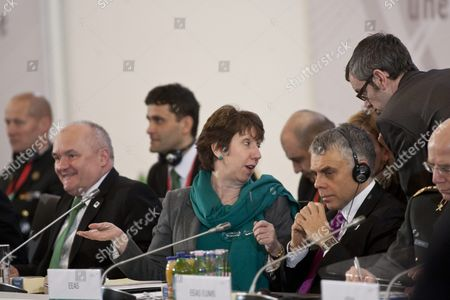 European Union High Representative For Foreign and Security Policy and Vice President of the European Commission Catherine Ashton (c) Gestures Sitting Between Hungarian Defence Minister Csaba Hende (l) and Deputy Secretary General For Inter-institutional Affairs of European External Action Service Maciej Popowski (r) at the Beginning of an Informal Meeting of Defence Ministers of Eu in Grassalkovich Palace in Goedoelloe Some 30 Km Northeast of Budapest Hungary 09 February 2011 Hungary Hosts the Meeting As Holder of the Rotating Presidency of the European Union As of 01 January 2011 Hungary Goedoelloe