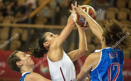 Stock Picture of Gunta Basko-melnbarde (c) of Latvia in Action Against British Players Chantelle Handy (l) and Dominique Allen (r) During the Women's Eurobasket Group C Match Between Latvia and Great Britain in Szombathely Hungary 13 June 2015 Hungary Szombathely