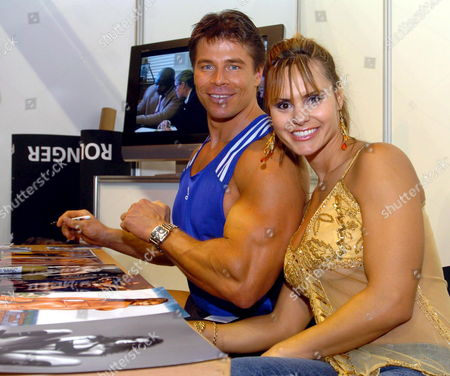 Fitness World Champion Timea Majorova (r) of Slovakia Poses with Body Builder Roland Kickinger (l) who Impersonates Arnold Schwarzenegger in a Film About the Life of the Californian Governor During a Fitness Festival in Debrecen 226 Kms East of Budapest Hungary Saturday 05 November 2005 Hungary Debrecen