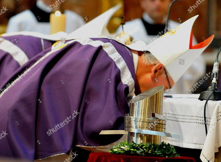 Priests Kiss the Altar Next to the Heart Urn of Otto Von Habsburg During the Funeral Mass at the Saint Stephen Basilica in Budapest Hungary 17 July 2011 Otto Von Habsburg was the Head of the Habsburg Dynasty Son of the Latest Hungarian King Charles Iv the Last Emperor of Austria who Died at the Age of 98 on 04 July 2011 in His Home in Poecking Germany Otto Von Habsburg's and His Wife Regina's Body Were Buried in the Imperial Crypt Below the Capuchin Church on 16 July 2011 in Accordance with a Habsburg Tradition Otto Von Habsburg's Heart Urn Will Be Laid to Rest in the Benedictine Abbey of Pannonhalma Some 50km West of Budapest Hungary Later in the Day Hungary Budapest