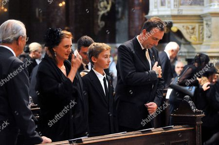 Three Members of the Habsburg Family Karl (r) Francesca and Their Son Ferdinand (c) Cross Themselves During the Funeral Mass For Otto Von Habsburg at the Saint Stephen Basilica in Budapest Hungary 17 July 2011 Otto Von Habsburg was the Head of the Habsburg Dynasty Son of the Latest Hungarian King Charles Iv the Last Emperor of Austria who Died at the Age of 98 on 04 July 2011 in His Home in Poecking Germany Otto Von Habsburg's and His Wife Regina's Body Were Buried in the Imperial Crypt Below the Capuchin Church on 16 July 2011 in Accordance with a Habsburg Tradition Otto Von Habsburg's Heart Urn Will Be Laid to Rest in the Benedictine Abbey of Pannonhalma Some 50km West of Budapest Hungary Later in the Day Hungary Budapest