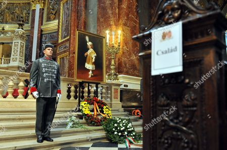 A Member of the Guard of Honour Stands in Front of a Painting Dated From 1916 Showing the Child Otto Von Habsburg Dressed in Vestment While Attending His Father's Coronation Ceremony Prior to the Funeral Mass For Otto Von Habsburg at the Saint Stephen Basilica in Budapest Hungary 17 July 2011 Otto Von Habsburg was the Head of the Habsburg Dynasty Son of the Latest Hungarian King Charles Iv the Last Emperor of Austria who Died at the Age of 98 on 04 July 2011 in His Home in Poecking Germany Otto Von Habsburg's and His Wife Regina's Body Were Buried in the Imperial Crypt Below the Capuchin Church on 16 July 2011 in Accordance with a Habsburg Tradition Otto Von Habsburg's Heart Urn Will Be Laid to Rest in the Benedictine Abbey of Pannonhalma Some 50km West of Budapest Hungary Later in the Day Hungary Budapest