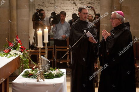 Asztrik Varszegi (r) Archabbot of Pannonhalma Prays in Front of the Heart Urn of Otto Von Habsburg in the Crypt of the Basilica of the Benedictine Abbey of Pannonhalma in Pannonhalma 130 Kms West of Budapest Hungary 17 July 2011 Otto Von Habsburg's Heart Urn Will Be Laid to Rest Here on the Deceased's Request Son of the Latest Hungarian King Charles Iv the Last Emperor of Austria Died on 04 July at His House in Poecking Germany Hungary Budapest