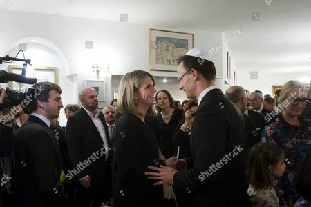 Us Ambassador to Hungary Colleen Bell (c) and Hungarian Minister of Foreign Affairs and Trade Peter Szijjarto Attend the Lighting Ceremony of the Menorah During the Jewish Festival Hannukah at the Israeli Ambassador Residence in Budapest Hungary 08 December 2015 Hungary Budapest