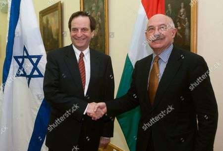 Hungarian Foreign Minister Janos Martonyi (r) Greets Israeli Deputy Prime Minister Dan Meridor in the Foreign Ministry in Budapest Hungary 17 February 2011 Dan Meridor is on a Working Visit to Hungary Hungary Budapest