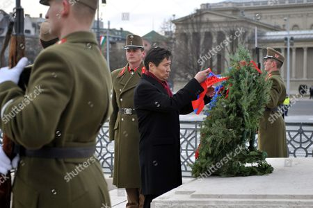 Mongolian Prime Minister Sukhbaataryn Batbold Arranges Ribbons As He Lays a Wreath at the Memorial Stone of Heroes in the Heroes' Square in Budapest Hungary 10 March 2010 Batbold is Staying on a Three-day Visit in Hungary Hungary Budapest