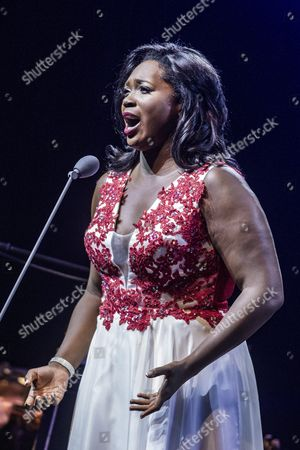 Us Soprano Angel Blue Performs on Stage During a Free Concert Hosted by Spanish Tenor Placido Domingo (not Pictured) at the Papp Laszlo Arena in Budapest Hungary 10 August 2016 Hungary Budapest