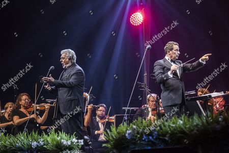 Spanish Tenor Placido Domingo (l) Performs on Stage Next to Conductor Eugene Kohn During a Free Concert at the Papp Laszlo Arena in Budapest Hungary 10 August 2016 Hungary Budapest
