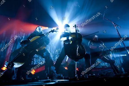 Stock Photo of Members of Finnish Heavy Metal Band Apocalyptica Perttu Kivilaakso (l) Eicca Toppinen (c) and Paavo Lotjonen (r) Perform in Petoefi Hall in Budapest Hungary 23 February 2011 Apocalyptica Are Currently on a World Tour Hungary Budapest