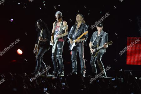 (l-r) Bass Guitarist Pawel Maciwoda Guitarists Rudolf Schenker Matthias Jabs and Singer Klaus Meine Perform During the Concert of German Rock Band Scorpions on the Memorial Day Dedicated to the 25th Anniversary of the Reburial of Martyr Prime Minister of the 1956 Revolution Imre Nagy and Fellow-martyrs in Budapest Hungary 16 June 2014 the Reburial in 1989 was One of the Decisive Steps Towards the Collapse of Communism in Hungary Hungary Budapest