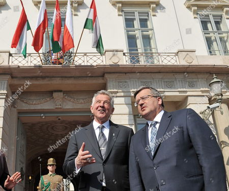 Polish President Bronislaw Komorowski (r) and His Hungarian Counterpart Pal Schmitt Chat in Front of the Presidential Alexander Palace in Budapest Hungary 22 March 2012 Komorowski Arrived For a Two-day Working Visit in Hungary on the Occasion of the Day of Hungarian-polish Friendship Hungary Budapest