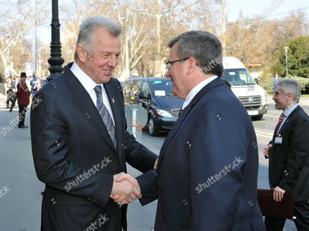 Polish President Bronislaw Komorowski (r) Shakes Hands with His Hungarian Counterpart Pal Schmitt As He Arrives For a Working Lunch with Corporate Leaders and Businessmen Engaged in Economic Ties of the Two Countries in Restaurant Gundel in Budapest Hungary 22 March 2012 Komorowski Arrived For a Two-day Working Visit in Hungary on the Occasion of the Day of Hungarian-polish Friendship Hungary Budapest