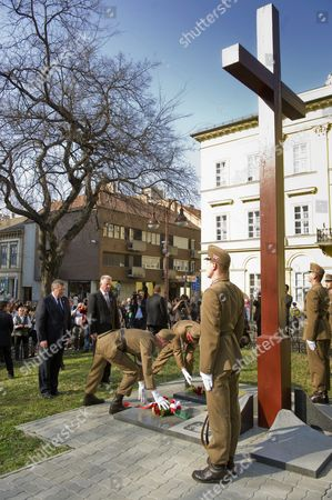 Polish President Bronislaw Komorowski (l) and His Hungarian Counterpart Pal Schmitt Lays Wreath at a Wooden Cross Erected to the Memory of the Victims of the Katyn Massacre in Szeged 170 Kms South of Budapest Hungary 23 March 2012 the Second Day of Komorowski's Two-day Working Visit to Hungary Paid on the Occasion of the Day of Hungary Szeged