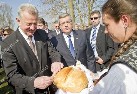 Polish President Bronislaw Komorowski (2-l) Looks on As His Hungarian Counterpart Pal Schmitt (l) is Offered Some Bread During Their Visit to the National Historic Memorial Park of Opusztaszer 148 Kms South of Budapest Hungary 23 March 2012 Komorowski Arrived on 22 March 2012 For a Two-day Working Visit in Hungary on the Occasion of the Day of Hungarian-polish Friendship Hungary Opusztaszer