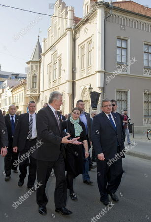 Polish President Bronislaw Komorowski (r) and His Hungarian Counterpart Pal Schmitt (l) Tour the Streets of Szeged 170 Kms South of Budapest Hungary 23 March 2012 the Second Day of Komorowski's Two-day Working Visit to Hungary Paid on the Occasion of the Day of Hungarian-polish Friendship at Centre an Unidentified Interpwreter is Seen Hungary Szeged