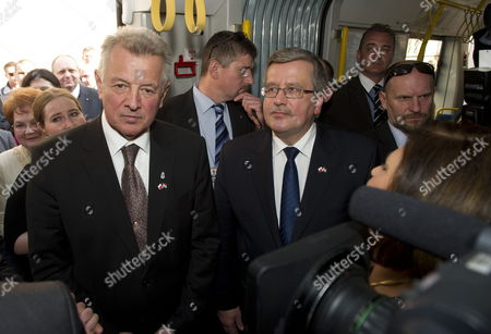 Polish President Bronislaw Komorowski (c) and His Hungarian Counterpart Pal Schmitt (l) Enter a Polish Made Pesa Tram of the Town's Public Transport System in Szeged 170 Kms South of Budapest Hungary 23 March 2012 the Second Day of Komorowski's Two-day Working Visit to Hungary Paid on the Occasion of the Day of Hungarian-polish Friendship Hungary Szeged