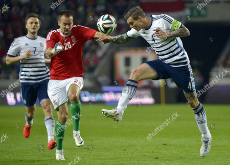 Peter Szakaly (l) of Hungary and Daniel Agger of Denmark Fight For the Ball During the Friendly Soccer Match Between Hungary and Denmark at the Nagyerdei Stadium in Debrecen Hungary 22 May 2014 Hungary Debrecen
