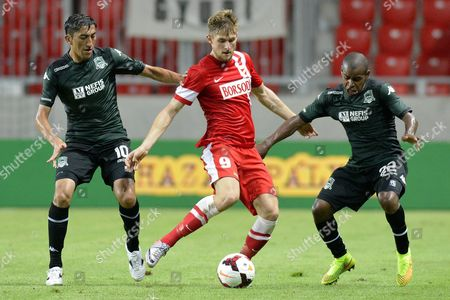 Patrik Bacsa (c) of Diosgyor of Hungary in Action Against Odil Ahmedov (l) and Joaozinho of Krasnodar of Russia During Their Uefa Europa League Third Qualifying Round First Leg Soccer Match in Nagyerdei Stadium in Debrecen 226 Kms East of Budapest Hungary 31 July 2014 Hungary Debrecen