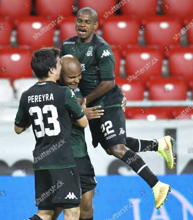 Arit (c) of Krasnodar of Russia Celebrates with His Teammates Mauricio Pereyra (l) and Joaozinho After He Scored a Goal Against Diosgyor of Hungary in Action Against Odil Ahmedov (l) During Their Uefa Europa League Third Qualifying Round First Leg Soccer Match in Nagyerdei Stadium in Debrecen 226 Kms East of Budapest Hungary 31 July 2014 Hungary Debrecen