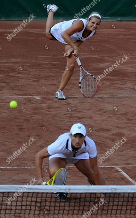 Doubles Team Members Tathiana Garbin of Italy (foreground) and Timea Bacsinszky of Switzerland (background) Are Seen During Their Final Match Versus Sorana Cirstea of Romania and Anabel Medina Garrigues of Spain at Tennis Women Gaz De France Suez Grand Prix Wta Tournament in Budapest Hungary 11 July 2010 Hungary Budapest