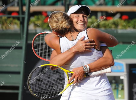 Doubles Team Members Tathiana Garbin of Italy (facing) and Timea Bacsinszky of Switzerland (backing) Hug After Beating Sorana Cirstea of Romania and Anabel Medina Garrigues of Spain in the Final of Tennis Women Gaz De France Suez Grand Prix Wta Tournament in Budapest Hungary 11 July 2010 Hungary out Hungary Budapest
