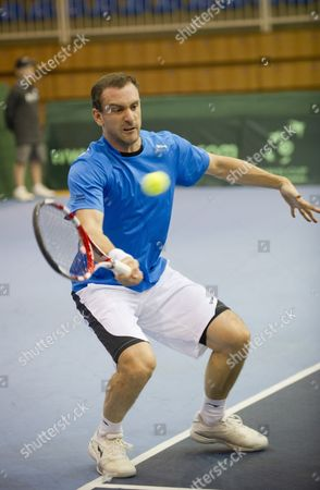 Stock Picture of Conor Niland of Ireland Returns the Ball to Marton Fucsovics of Hungary During Their Single Match of the Hungary Vs Ireland Tennis Davis Cup Euro-african Zone 2nd Group Match in Szeged 170 Kms South of Budapest Hungary 10 February 2012 Hungary Szeged