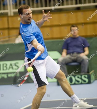 Conor Niland of Ireland Returns the Ball to Marton Fucsovics of Hungary During Their Single Match of the Hungary Vs Ireland Tennis Davis Cup Euro-african Zone 2nd Group Match in Szeged 170 Kms South of Budapest Hungary 10 February 2012 Hungary Szeged