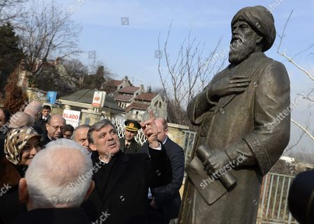 Turkish President Abdullah Gul (c) and His Wife Hayrunnisa Gul (l) Watch the Statue of the Famous Turkish Poet Gul Baba (or Father of Roses) in Budapest Hungary 18 February 2014 Gul Baba was a Muslim Dervish and Member of the Bektashi Order who Died After the Capture of Buda in 1541 According to a Legend Gul Baba Introduced the Roses in Budapest Turkish President Abdullah Gul is on a Three-day Official Visit in Hungary Hungary Budapest