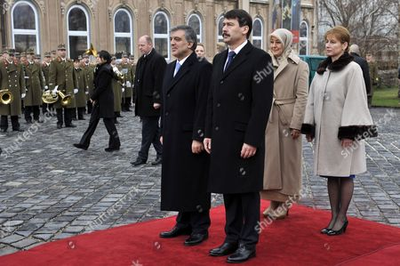 Turkish President Abdullah Gul (l) and His Hungarian Counterpart Janos Ader and Their Wives Hayrunnisa Gul (2-r) and Anita Herczeg (r) Review Honour Guards During the Welcoming Ceremony at Presidential Alexander Palace in Budapest Hungary 17 February 2014 Gul is on a Three-day Official Visit to Hungary Hungary Budapest