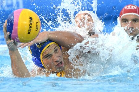 Valentino Gallo (c) of Italy Challenges Sasa Misic of Montenegro For the Ball During Their Match For the Mens Bronze Medal of European Water Polo Championships in Hajos Alfred Swimming Pool in Budapest Hungary 27 July 2014 Hungary Budapest