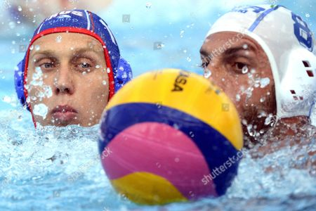 Nikita Yankov (l) of Russia and Valentino Gallo of Italy Fight For the Ball During the Group a 1st Round Match Between Italy and Russia During the Men's Waterpolo European Championships in the Hajos Alfred Swimming Pool in Budapest Hungary 14 July 2014 Hungary Budapest