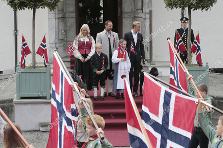 (l-r) Members of the Norwegian Crown Prince Family Crown Princess Mette-marit Prince Sverre Magnus Crown Prince Haakon Princess Ingrid Alexandra and Marius Borg Hoiby Look at Parading Children During Celebrations of the Norwegian Constitution Day Outside the Royal Residence Skaugum in Asker Norway 17 May 2014 the Norwegian Constitution was Signed in Eidsvoll on 17 May 1814 Norway Asker