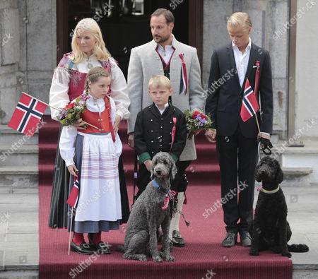 (l-r) Members of the Norwegian Crown Prince Family Crown Princess Mette-marit Princess Ingrid Alexandra Prince Sverre Magnus Crown Prince Haakon and Marius Borg Hoiby Look at Parading Children During Celebrations of the Norwegian Constitution Day Outside the Royal Residence Skaugum in Asker Norway 17 May 2014 the Norwegian Constitution was Signed in Eidsvoll on 17 May 1814 Norway Asker