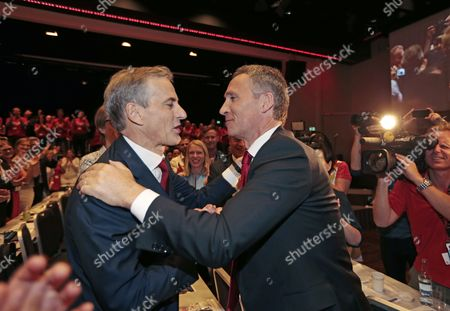 New Chairman of the Norwegian Labour Party Jonas Gahr Stoere (l) is Congratulated by out Going Chairman Jens Stoltenberg (r) at a Party Meeting in Oslo Norway 14 June 2014 Stoere Succeeds Jens Stoltenberg who Will Take on the Post of Secretary General of Nato Later in 2014 Norway Oslo