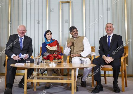 Stock Photo of (l-r) Secretary of the Norwegian Nobel Committee Geir Lundestad Nobel Peace Prize Laureates Malala Yousafzai and Kailash Satyarthiand and Chair of the Norwegian Nobel Committee Thorbjorn Jagland Attend Press Conference at the Norwegian Nobel Institute in Oslo Norway 09 December 2014 the Nobel Peace Prize Award Ceremony and the Nobel Banquet Will Take Place in Oslo on 10 December Norway Oslo