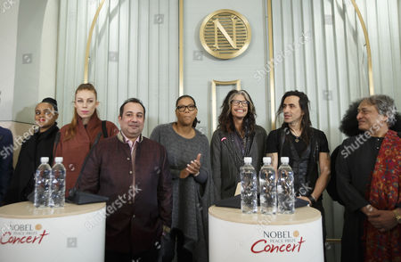 (l-r) Seinabo Sey Gabrielle Ustad Rahat Fateh Ali Khan Queen Latifah Steven Tyler Nuno Bettencourt and Amjad Ali Khan Attend a Press Conference in Oslo Norway 11 December 2014 Tyler is Among the Artist to Appear at the Nobel Peace Prize Concert on 11 December Norway Oslo