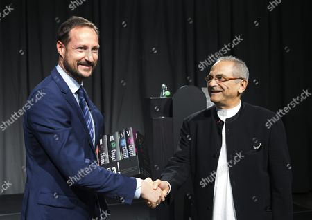 Crown Prince Haakon of Norway (l) Receives the Chega! the Final Report of the Timor-leste Commission For Reception Truth and Reconciliation (cavr) From Nobel Peace Prize Laureate Jose Ramos-horta (r) in Oslo Norway 25 January 2016 the Handover of the Report Takes Place 20 Years After Ramos-horta and Carlos Filipe Ximenes Belo Received the Nobel Peace Price in Oslo Norway Oslo