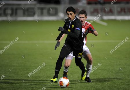 Tromso's Lars Gunnar Johnsen (r) Fights For the Ball with Anzhi's Odil Ahmedov (l) During Their Europa League Soccer Match in Tromso Norway 07 November 2013 Norway Tromso