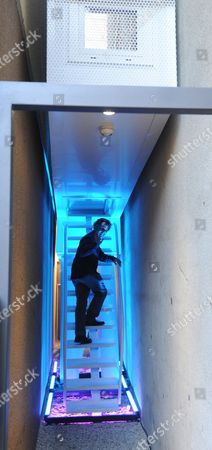 Stock Photo of Israeli Writer Etgar Keret Poses For a Picture on the Steps of His Art Installation During Its Opening in Warszawa Poland 20 October 2012 'Keret House' Allegedly Narrowest House in the World is a Home - Art Installation - with a Width of 152 Cm to 92 Cm Between the Pre-war Apartment Building in Warsaw's Wola the 'Keret House' Will Invite Artist in Residence to Live and Create Their Works in the Space Poland Warszawa