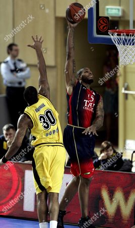A Picture Dated 04 March 2009 Shows Will Mcdonald (r) of Tau Ceramiaca Vitoria Trying to Score As Ronnie Burrell (l) of Asseco Prokom Sopot Defends During Their Top 16 Euroleague Basketball Match in Gdynia Poland Poland Gdynia
