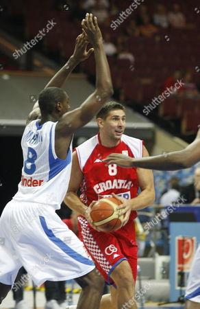Ian Mahinmi (l) of France Fights For the Ball with Nikola Prkacin (c) of Croatia During Their Fiba European Basketball Championship 5th Place Match in Katowice Poland 20 September 2009 Poland Katowice