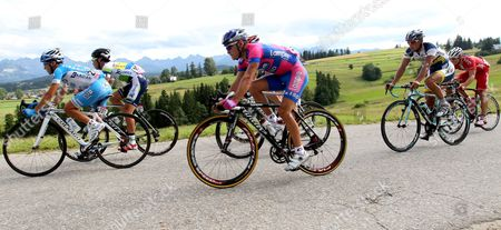 Italy's Demonico Pozzovivo (l) of Colnago-csf Inox Team and Japan's Fumiyuki Beppu (2l) of Orica-greendedge in Action During the 5th Stage of the Tour De Pologne Cycling Race Over 163 1 Km From Rabka Zdroj to Zakopane in the Tatra Mountains Poland 14 July 2012 Poland Zakopane