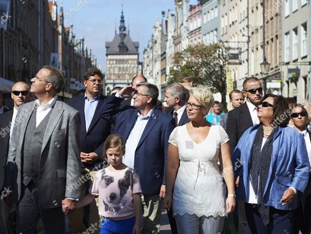 President of Estonia Toomas Hendrik Ilves (l) His Wife First Lady Evelin Ilves (2-r) and Their Daughter Kadri Keiu (c) Along with President of Poland Bronislaw Komorowski (c) and His Wife First Lady Anna Komorowska (r) Walk in the Old Town Quarter in Gdansk Poland 21 August 2012 the President of Estonia with His Family is on an Unofficial Visit to Poland at the Invitation of Polish Presidential Couple Poland Gdansk