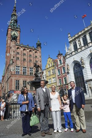 President of Estonia Toomas Hendrik Ilves (2-l) and His Wife First Lady Evelin Ilves (3-l) and Their Daughter Kadri Keiu (2-r) Along with President of Poland Bronislaw Komorowski (r) and His Wife First Lady Anna Komorowska (l) Pose For a Photo with the Neptun Monument in the Old Town Quarter in Gdansk Poland 21 August 2012 President of Estonia with His Family is in an Unofficial Visit to Poland at the Invitation of Polish Presidential Couple Poland Gdansk