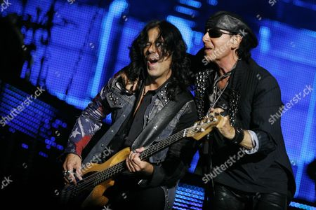 Bassist Pawel Maciwoda (l) and Vocalist Klaus Meine (r) of the German Band Scorpions During Their Concert at the 'Rock For Freedom: Legends of Rock' Festival in Wroclaw Poland 31 August 2012 Poland Wroclaw