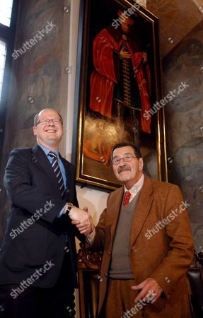 Nobel Prize-winning German Author Gunter Grass (r) and Gdansk Mayor Pawel Adamowicz (l) Shake Hands During Press Conference in Gdansk Poland 06 October 2007 Grass was Born on 16 October 1927 in Gdansk where He Will Celebrate His 80th Birthday Poland Gdansk