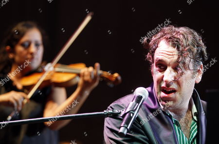 Canadian Pianist Producer and Songwriter Chilly Gonzales (r) with Aukso Tychy Chamber Orchestra Perform During a Concert at the Tauron New Music Festival in Katowice 23 August 2012 Poland Katowice